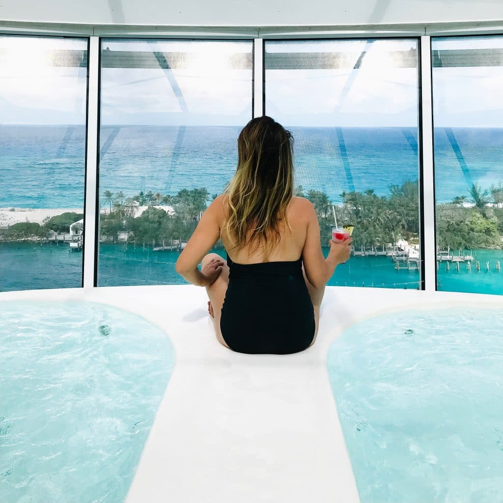 woman sitting on a jacuzzi on symphony of the seas