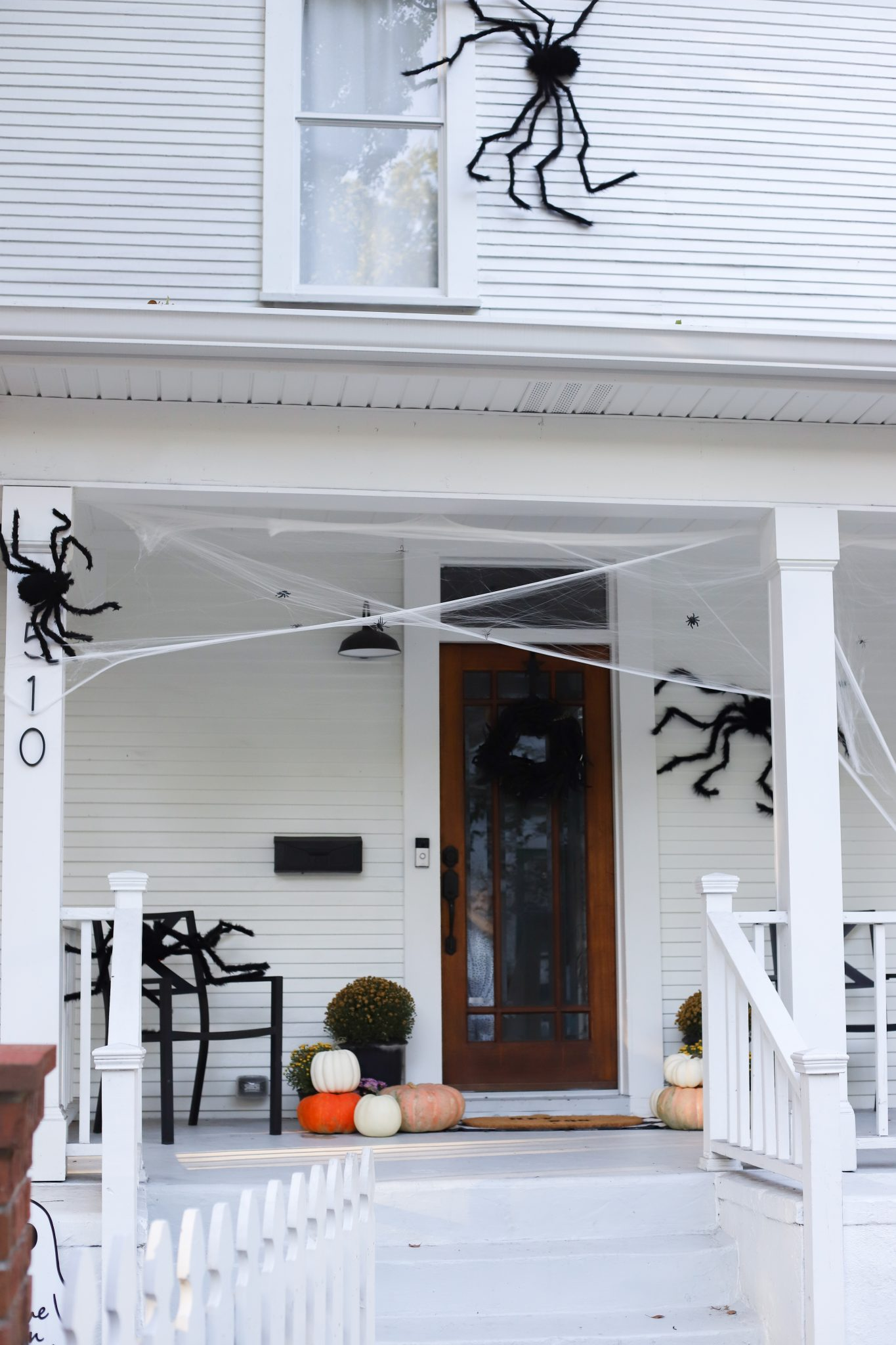 classic black spiders on a white farmhouse #halloween