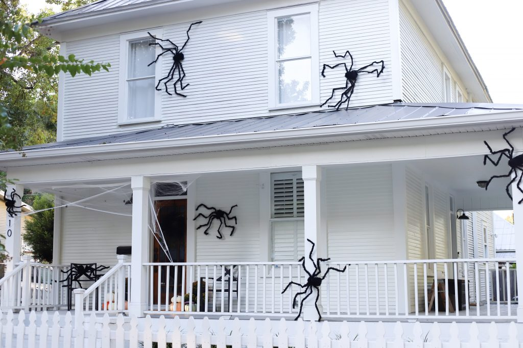 classic black spiders on a white farmhouse - simple exterior home decor #halloween