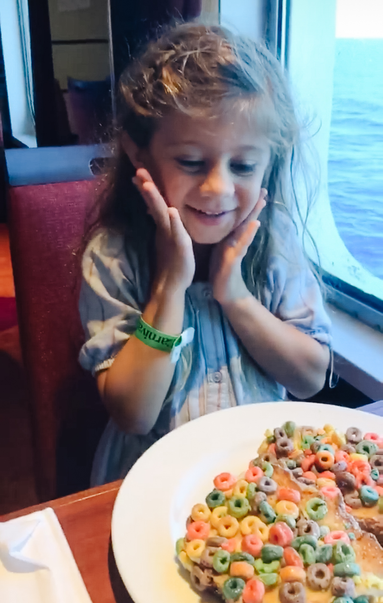 Little girls eating fruit loop French toast on the Carnival Breeze with kids